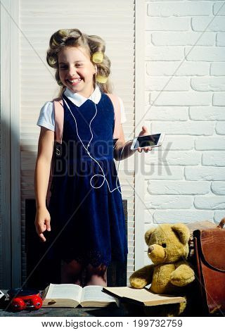 Small Girl With Curler In Hair With Headset And Phone.