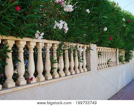 Details of a fence of traditional classical local Spanish style house private villa home real estate Spain