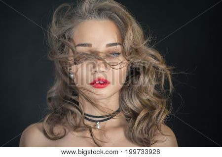 luxury sensual woman with curly long hair on black background