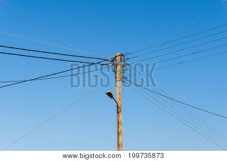 View on an old Power Lines in front of a clear Sky. Close-up of Power Lines.