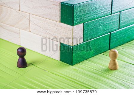 Unexpected meeting business competition. A stranger at a bend an abstract composition of wooden blocks.