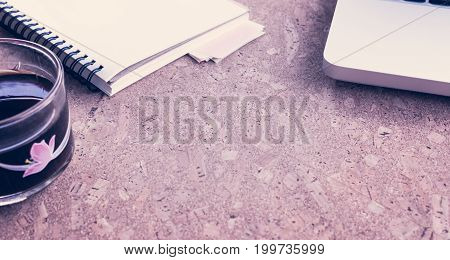 Working Desk Table Concept. Office Desk Table With Laptop, Blank Paper Notebook,cup Of Coffee And Sm