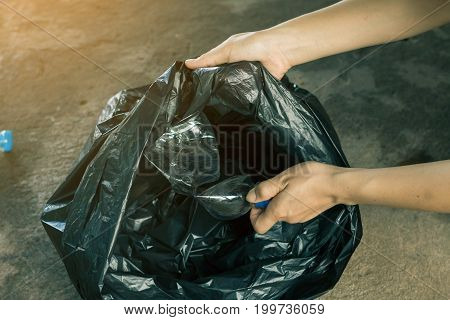 Women volunteer help garbage collection charity environment.