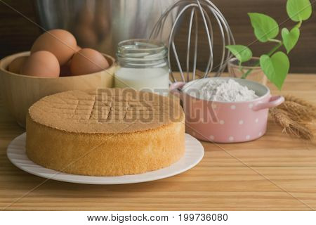 Homemade Sponge Cake On White Plate.soft And Lite Delicious Sponge Cake With Ingredients: Eggs Flour