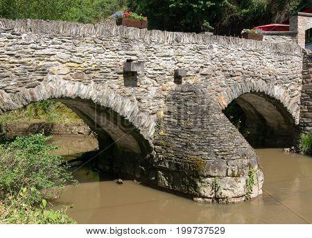 Old stone bridge of Monreal, Eifel, Germany