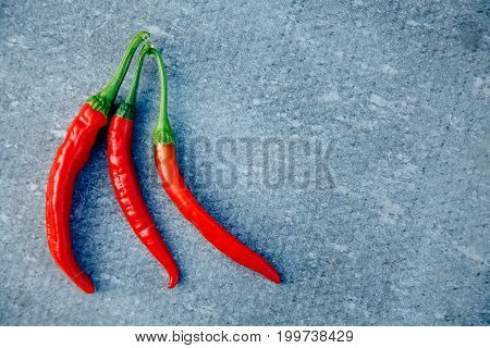 Close-up of chili pepper on a gray background. concept is scalding, spicy, spicy.