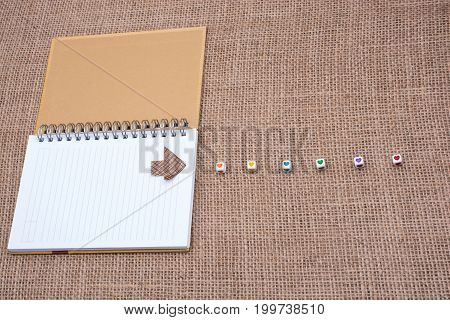 Love Cubes And Paper Arrow On A Notebook