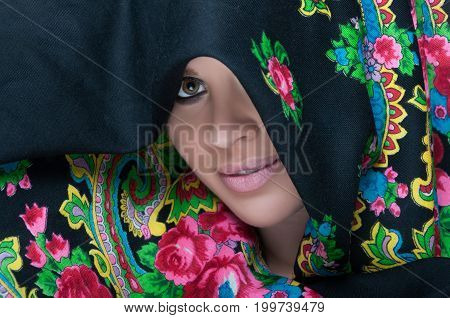 Close-up View Of Female Portrait Wearing Scarf
