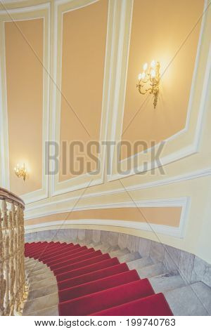 Marble stairs with red carpet - Interior architecture image from a luxury building with the marble stairs covered by a red carpet