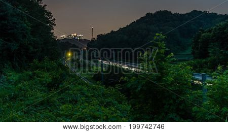 Long Exposure Night Photo Of Train Moving At High Speed