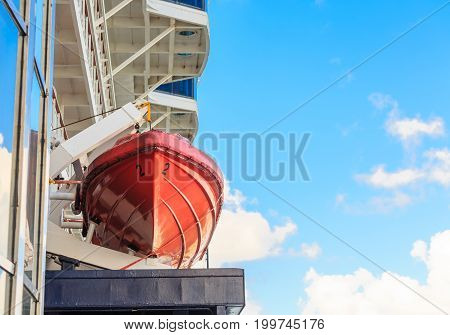 Orange Lifeboat in Ship Harness Under Sky