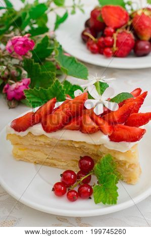 Napoleon cake with strawberries. Wihte background. Top view. Close-up