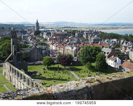 St Andrews city in SCOTLAND with view on ruins of gothic cathedral seen from medieval tower in UNITED KINGDOM with cloudy sky in 2016 warm summer day, GREAT BRITAIN, UK, Europe on August.