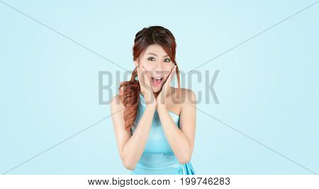Beautiful girl with expressive emotions. Young beauty asian woman surprise faceexcited Isolated on gray background