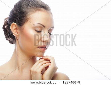 lifestyle, beauty and people concept: young happy woman with clean skin isolated on white