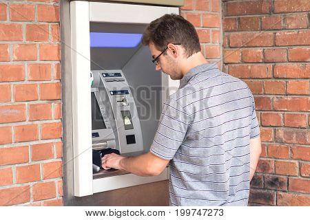 Man Using Atm Bank Machine