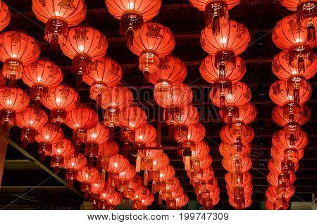 Red Chinese Paper Lanterns decoration taken at night walking street in bangkok Thailand.