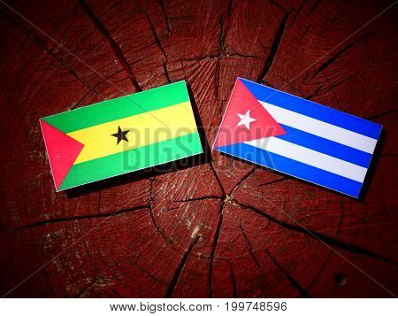 Sao Tome And Principe Flag With Cuban Flag On A Tree Stump Isolated