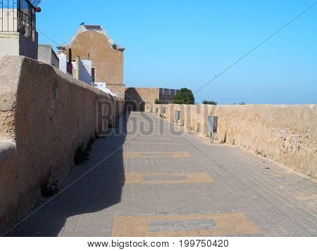 Fortress of MAZAGAN city landscape with arabic ancient fortification citadel walls located in MOROCCO in AFRICA with clear blue sky in 2016 warm sunny winter day on February.