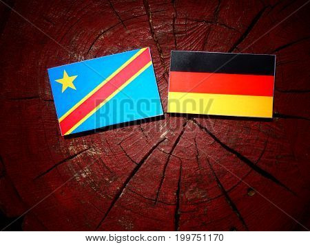 Democratic Republic Of The Congo Flag With German Flag On A Tree Stump Isolated