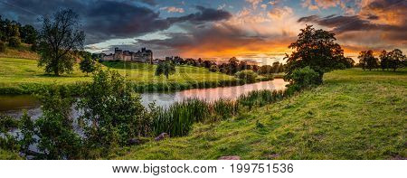 Panoramic Sunset over River Aln, which runs through Northumberland from Alnham to Alnmouth. Seen here in panorama below Alnwick Town and Castle on the skyline as the sunsets