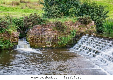 Fish Pass at River Aln Weir. The River Aln runs through Northumberland from Alnham to Alnmouth. Here below Alnwick is one of the weirs along its length