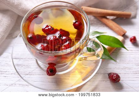 Glass cup of brier tea on wooden table. Weight loss concept