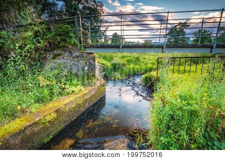 River Aln Footbridge, the river running through Northumberland from Alnham to Alnmouth. Seen here beginning to widen just after Alnham