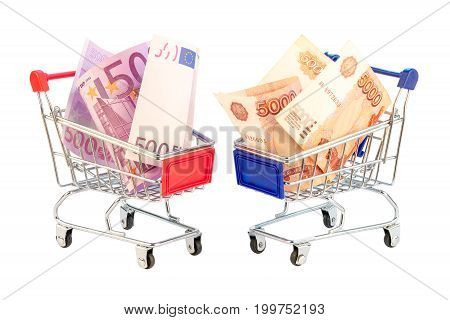 Euro and ruble bills in shopping cart isolated