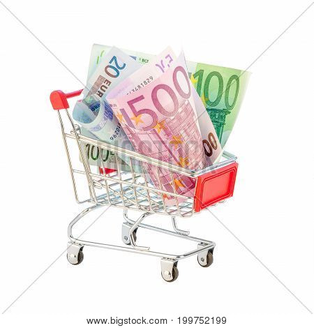New euro bills in shopping cart isolated