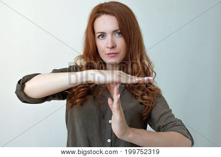 Young woman showing time out hand gesture Too many things to do. Human emotions face expression reaction
