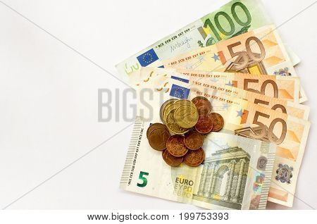European coins on the various Euro banknotes like background.