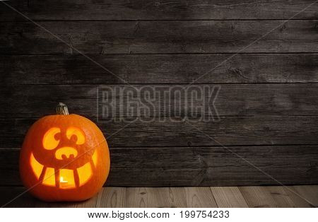 the halloween pumpkin on old  wooden background