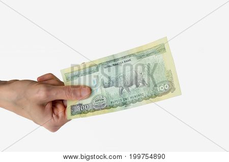 Woman Holding A Hundred Nepal Rupees Note In Her Hand