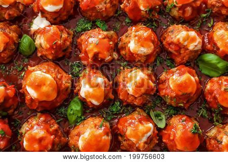 Delicious turkey meatballs with tomato sauce, closeup