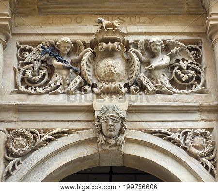 carvings on the entrance above the door of halifax town hall in calderdale a former court with emblems and a figure of justice