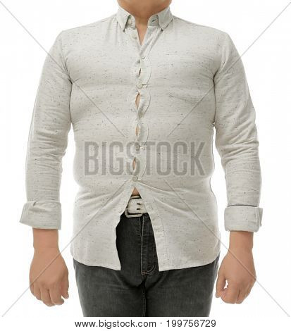 Diet concept. Overweight man in tight shirt on white background
