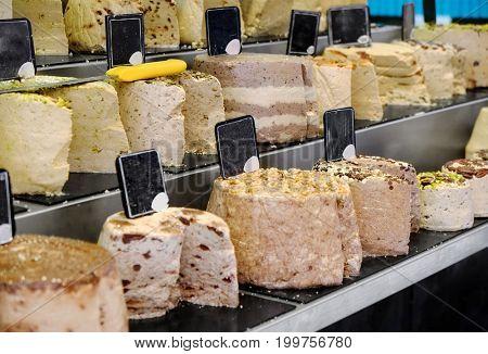Different types of halva at market