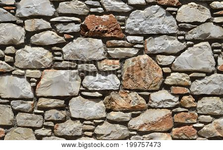 stone wall composed of smaller and larger stone