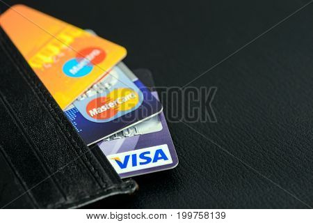 Moscow, Russia - August 05, 2017: Visa and Mastercard credit cards in leather wallet