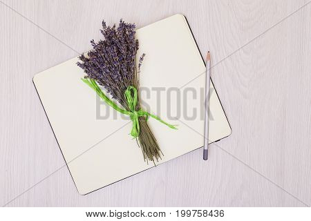Flowers lavender and empty sketchbook floral frame from dried plants flat lay background. Open sketchbook. notebook