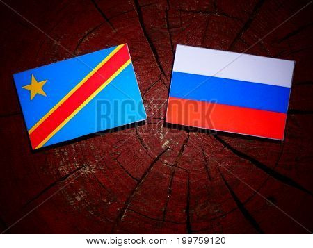 Democratic Republic Of The Congo Flag With Russian Flag On A Tree Stump Isolated