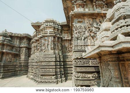 Ornate corner of the 12th century Hoysaleshwara temple with portraits of Ganesha and Lord Brahma in ancient city Halebidu, India