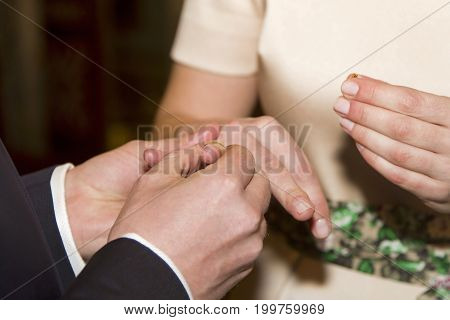 The tradition of exchanging gold rings at a wedding ceremony