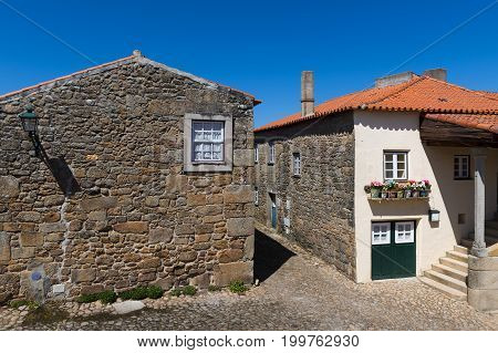Two traditional colorful houses in the historic village of Castelo Mendo in Portugal; Concept for travel in Portugal