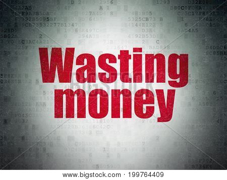 Money concept: Painted red word Wasting Money on Digital Data Paper background
