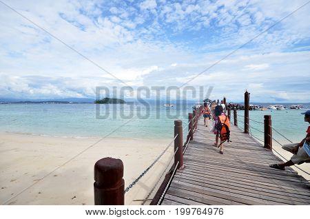 Tourists Walk On Manukan Island Footbridge In Malaysia