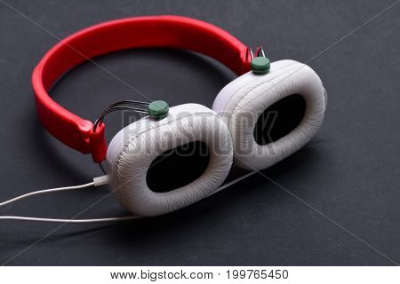 Modern And Stylish Earphones On Dark Background