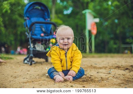 Toddler Boy Playing With Sand On The Beach Development Of Fine Motor Skills