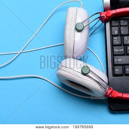 Electronics On Light Blue Background. Music And Digital Equipment Concept